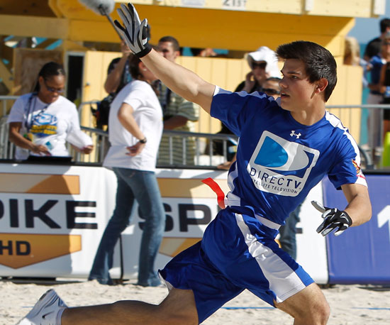 Slide Photo of Taylor Lautner Playing Football