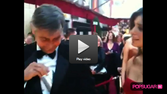 Video of George Clooney Flashing His Oscar Night Flask!