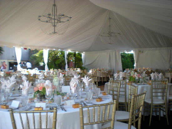 Michelle and Doug chose to have their reception outdoors under a very elegant tent. As the sun went down the chandeliers and can lighting created a very romantic atmosphere.