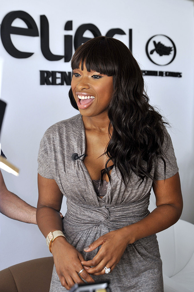 Jennifer Hudson stopped by Renault lounge sporting a comfortable yet chic gray dress and major bling. Note the bra peek-a-boo.