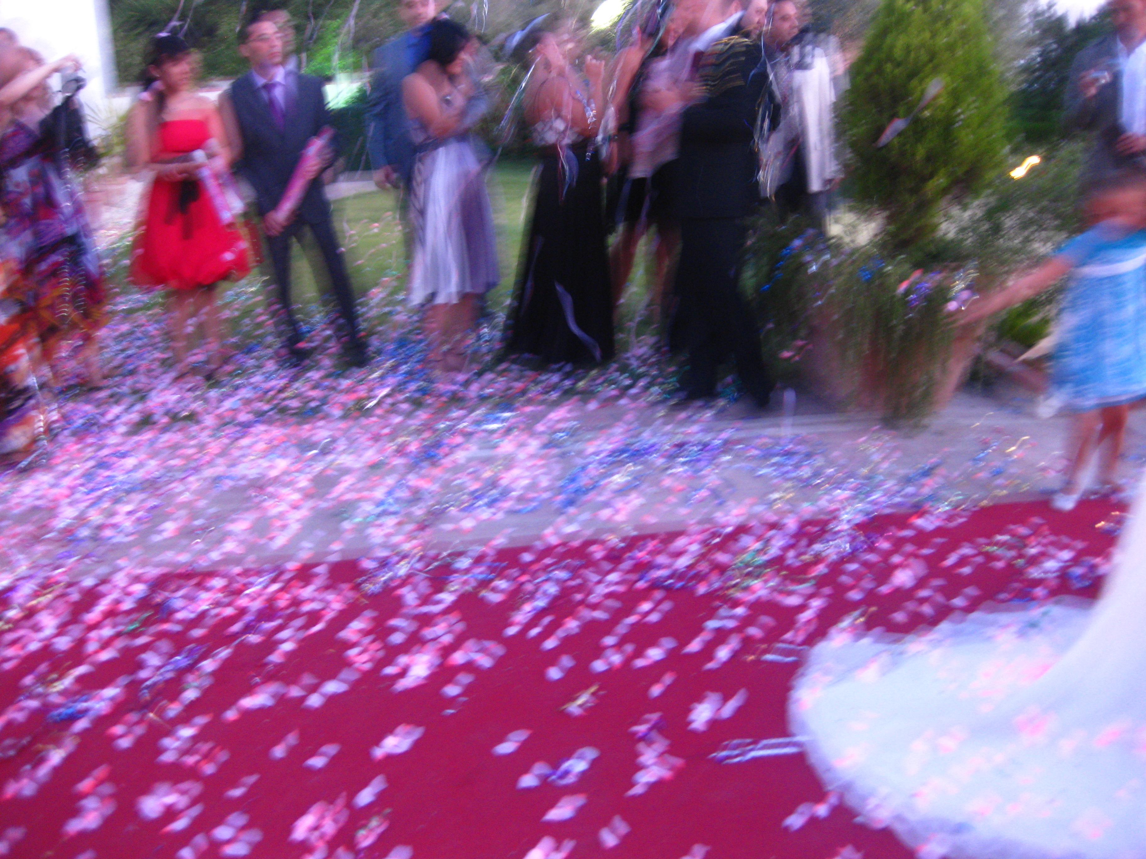 As the married couple left the tent, everyone showered them with confetti from the super poppers.