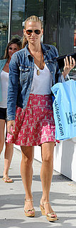 Molly Sims Shops at Kitson Wearing Pink and White Skirt with Jean Jacket