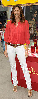 Cindy Crawford at Alex's Lemonade Stand Grand Opening Wearing Orange Tunic and White Jeans