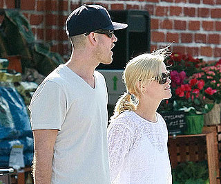 Slide Picture of Reese Witherspoon and Jim Toth Holding Hands in LA
