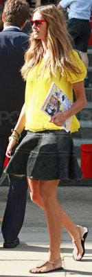 Elle Macpherson Wearing Yellow Peasant Top and Red Sunglasses in London
