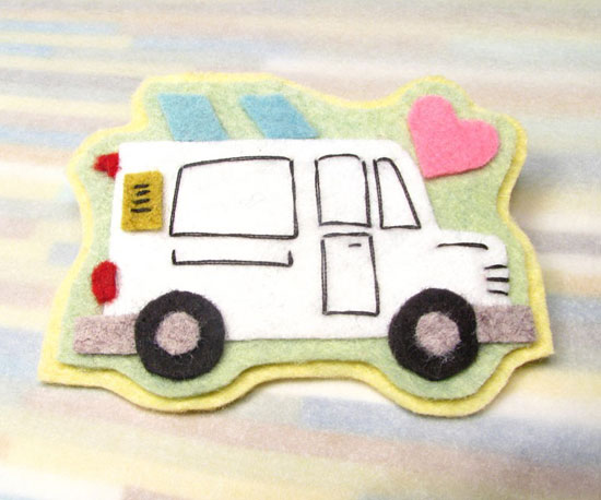 This felt brooch ($12) is a little Regretsy for my taste, but it would be cute for a young food truckie in the making!
