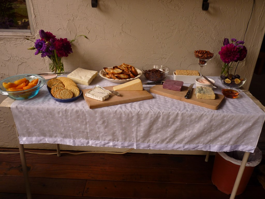 The spread of cheese was laid out on a small folding table. I made the tablecloth out of white eyelet cotton.