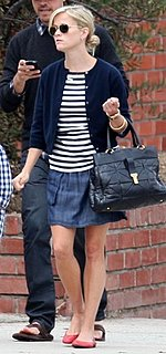 Reese Witherspoon Wearing a Denim Skirt and Ray Ban Aviators