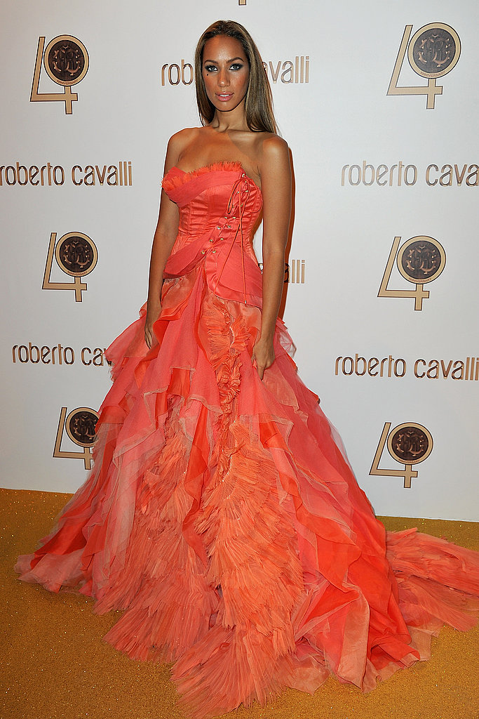Leona Lewis is dressed to party in a ruffled, peach and orange confection.