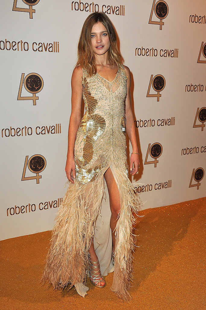 Natalia glows in glossy gold feathers and fringe.