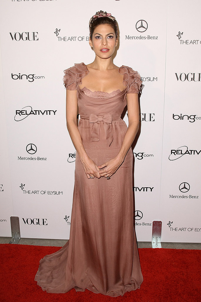 Eva Mendes is ultra romantic in a frilly gown and flower headpiece.