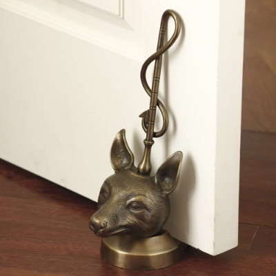 My vote goes to the fox. It's been popping up in artwork, on pillows, and even on doorknockers and doorstops, including this Victorian Fox Doorstop ($70).