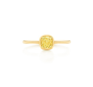 The mother of all engagement rings — this one is sure to turn a few heads in your direction.  Tiffany Tiffany Bezet Yellow Diamond Ring ($28,700)