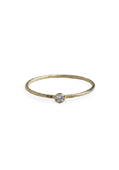 We adore the simple textured band and small diamond