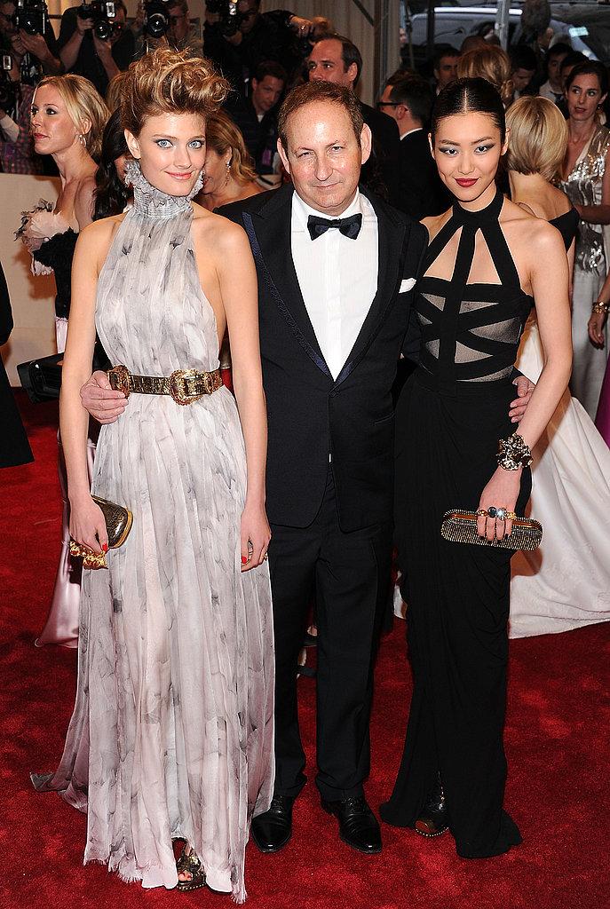 Constance Jablonski and Liu Wen, both in Alexander McQueen, with Estee Lauder's John Demsey
