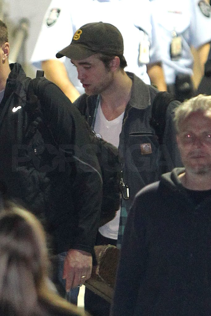 Robert Pattinson and Reese Witherspoon Land Down Under For More Press Duties