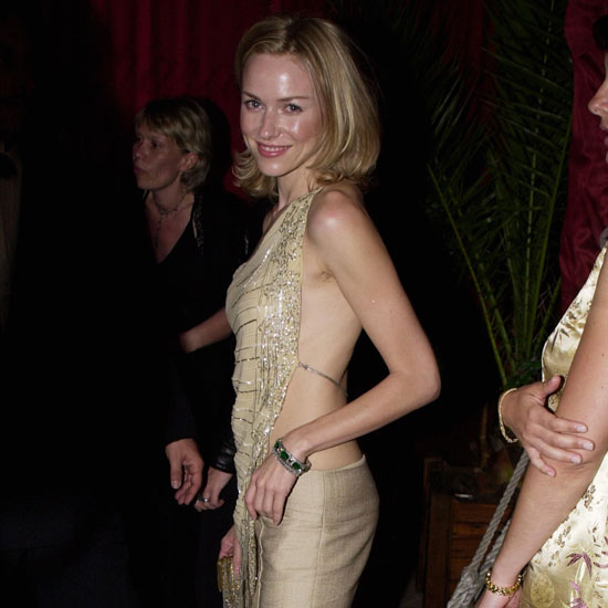 Naomi Watts wore a backless top for a beach party in 2001.