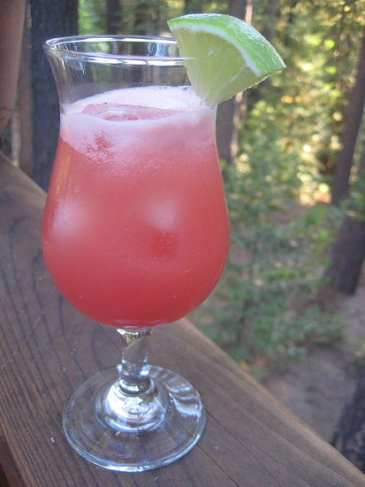 Cool down with this watermelon margarita. A slice of lime is the perfect garnish for this boozy Summer treat.