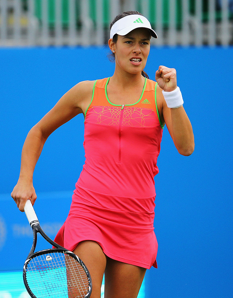 Ana Ivanovic kept up with this seasons neon color trend in a hot pink, orange, and green dress.