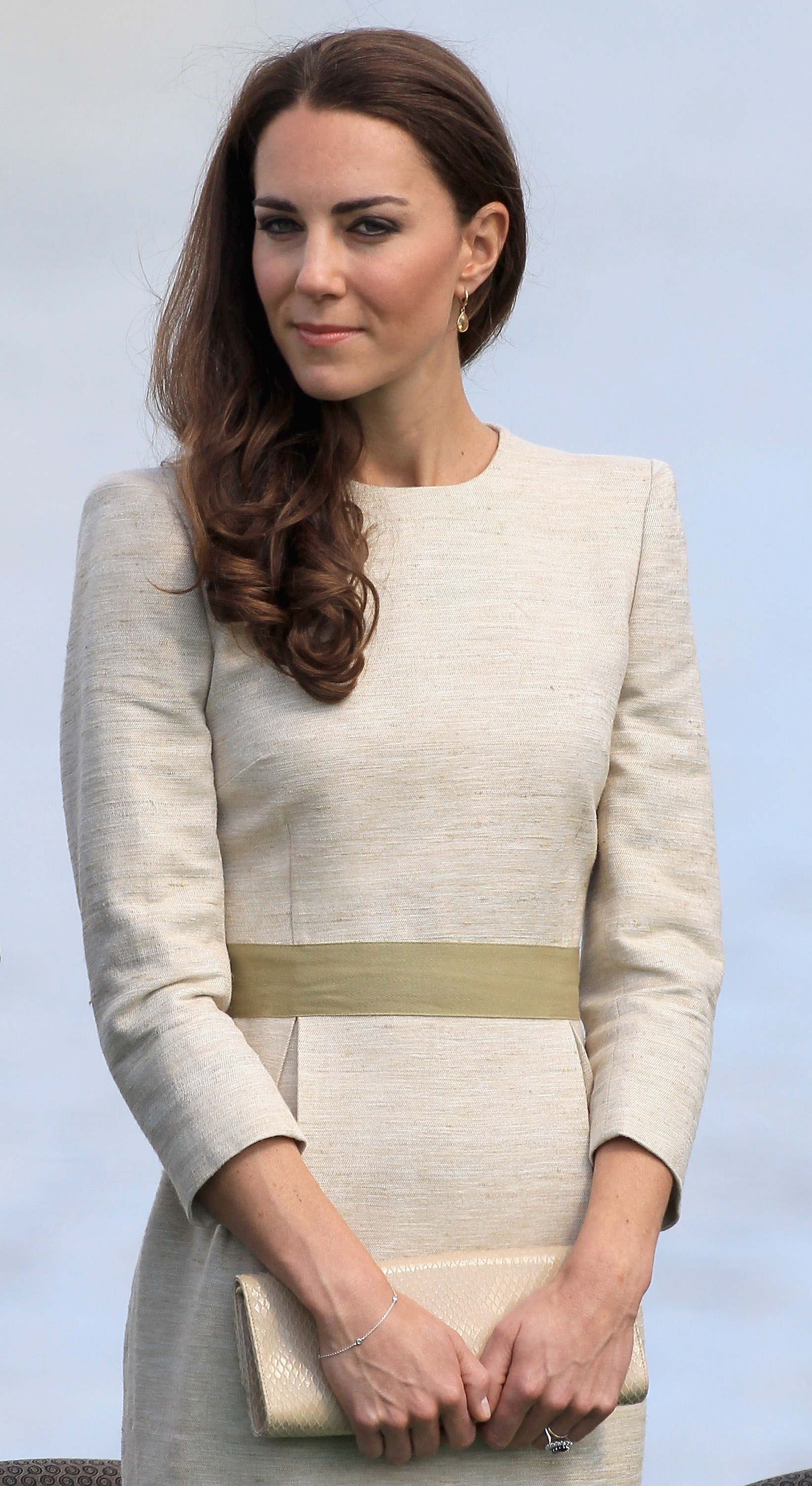 July 5th, 2011  Attending an official welcome ceremony at the Somba K'e Civic Plaza on in Yellowknife, Canada.  Kate wears a silk linen weave Marlene Birger Bullet Dress with an eggshell envelope clutch and Kiki McDonough Citrine Drop earrings.