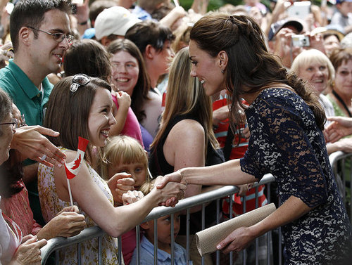 Kate Middleton shook hands with some of her young admirers.