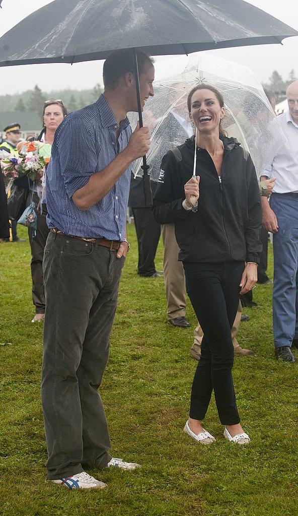 Kate Middleton and Prince William smiled despite the rain.