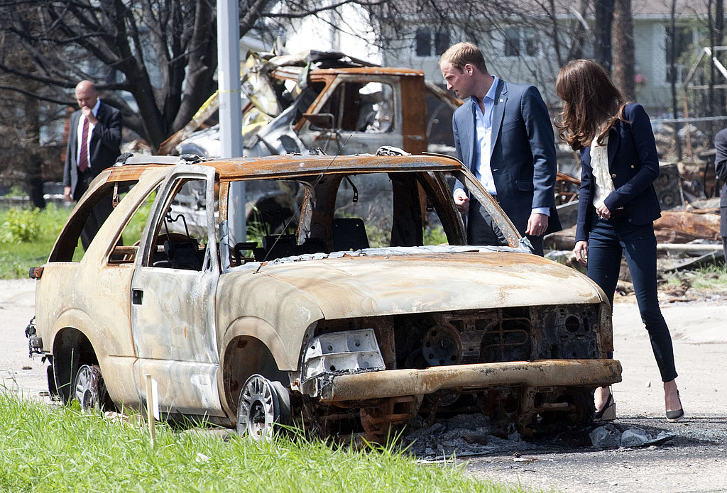 Kate Middleton and Prince William look at fire damage in Alberta.