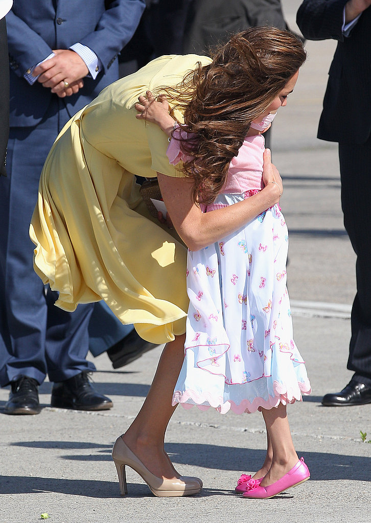 Kate Middleton hugged a young well wisher.