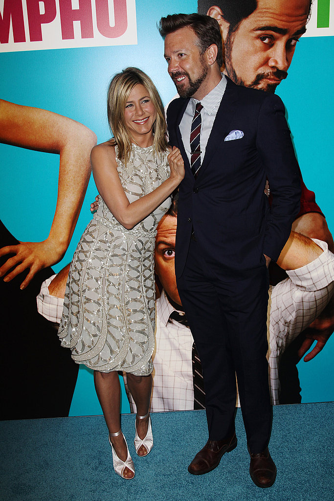 Jennifer Aniston and Jason smiling.