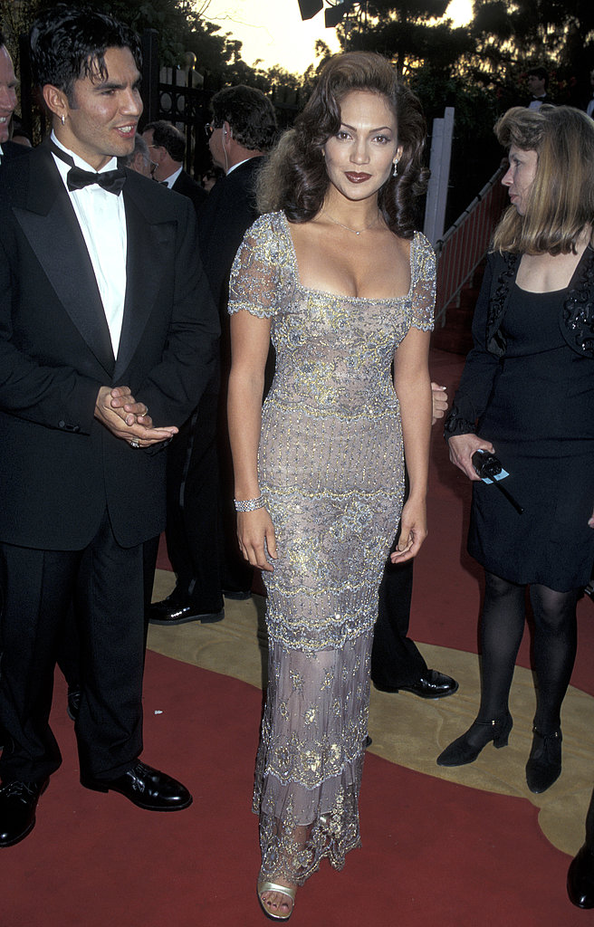 A retro-inspired coif and a bead and embellished gown at the '97 Oscars.