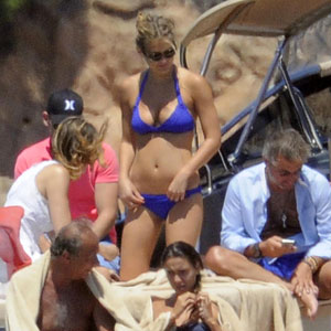 Bar Refaeli Wearing a Purple Bikini in Italy Pictures