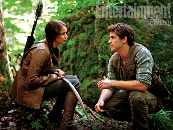 Jennifer Lawence as Katniss and Liam Hemsworth as Gale in The Hunger Games.