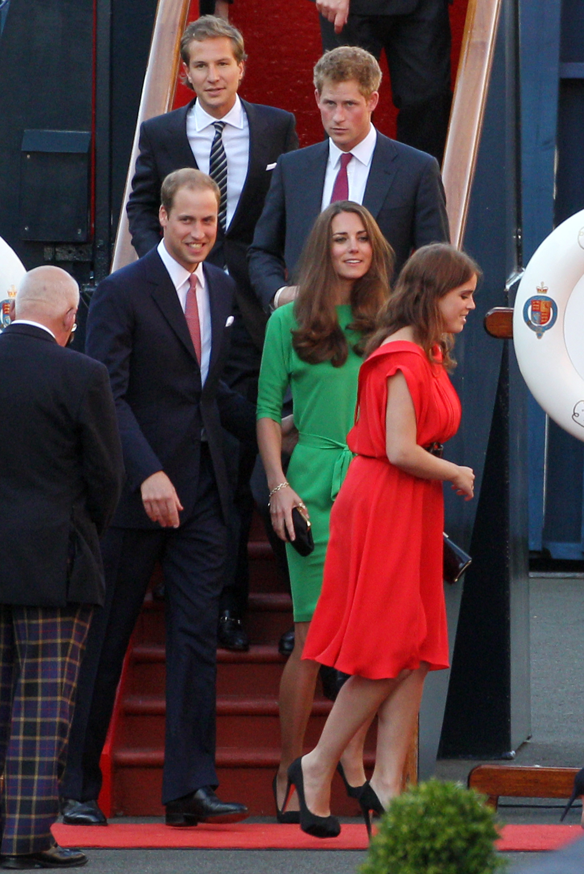 Dave Clark, Prince Harry, Prince William, Kate Middleton, and Princess Eugenie leave Mike and Zara's wedding drinks.
