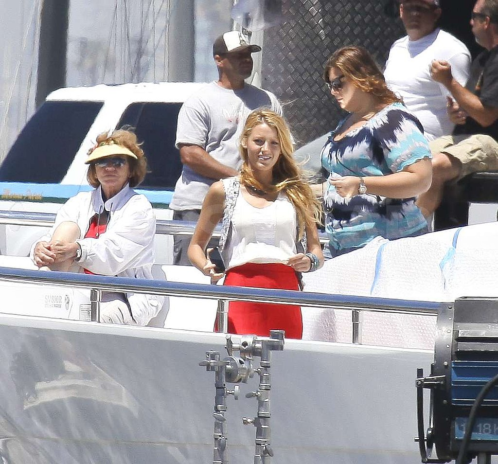 Blake smiled in the sun on the yacht.