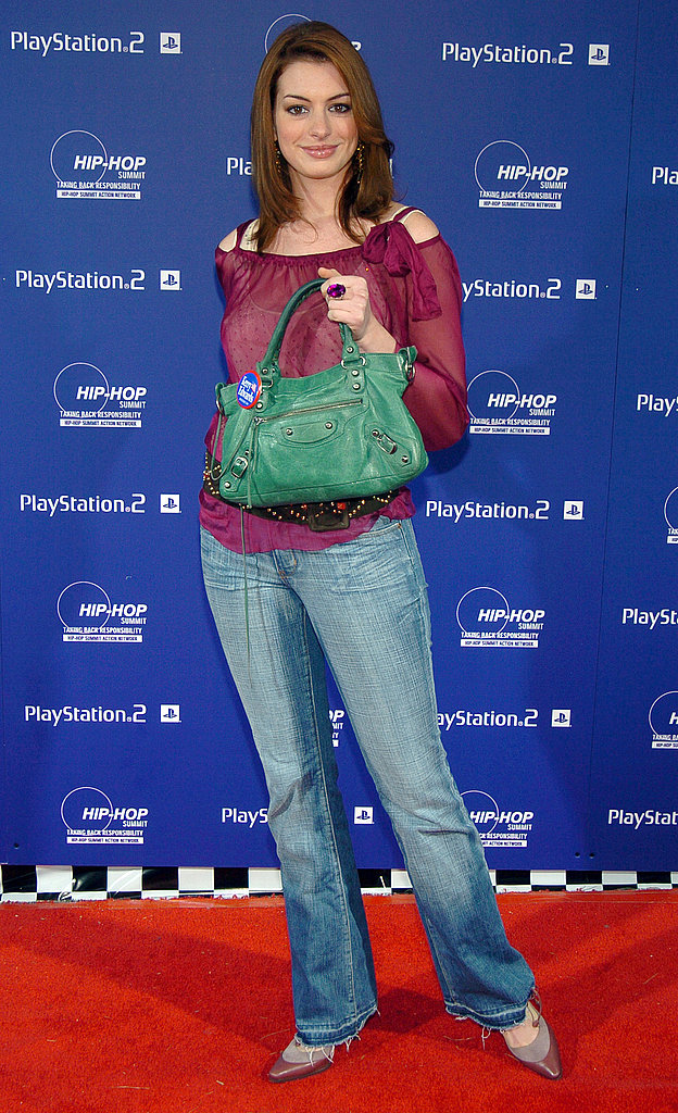 Still sticking to a casual vibe — and showing off an emerald Balenciaga bag — in October 2004.