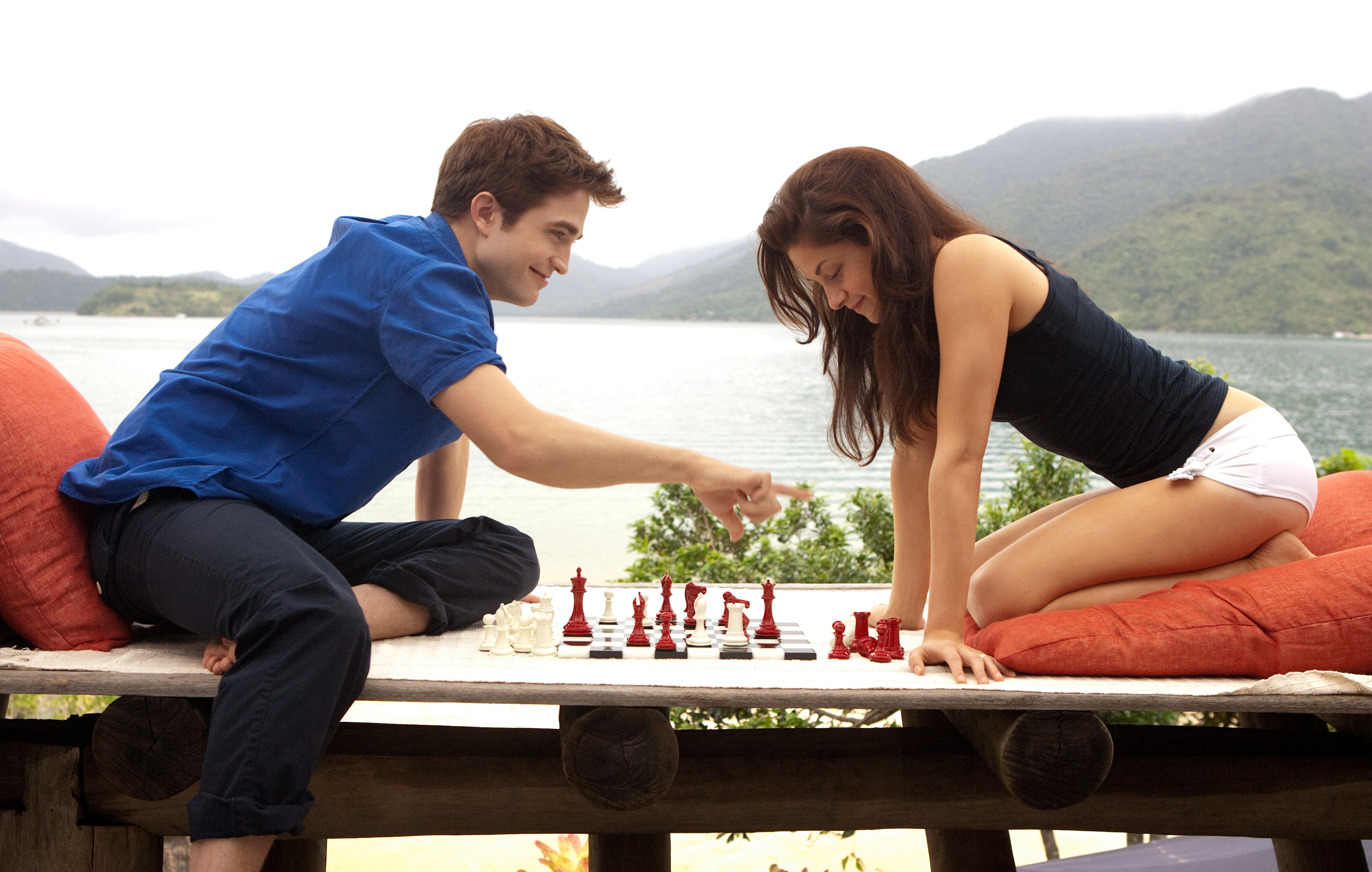 Bella and Edward challenge each other to a game of chess.