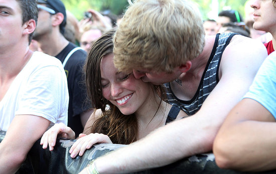 This fella snuck in a smooch during the Pitchfork Music Festival in Chicago.