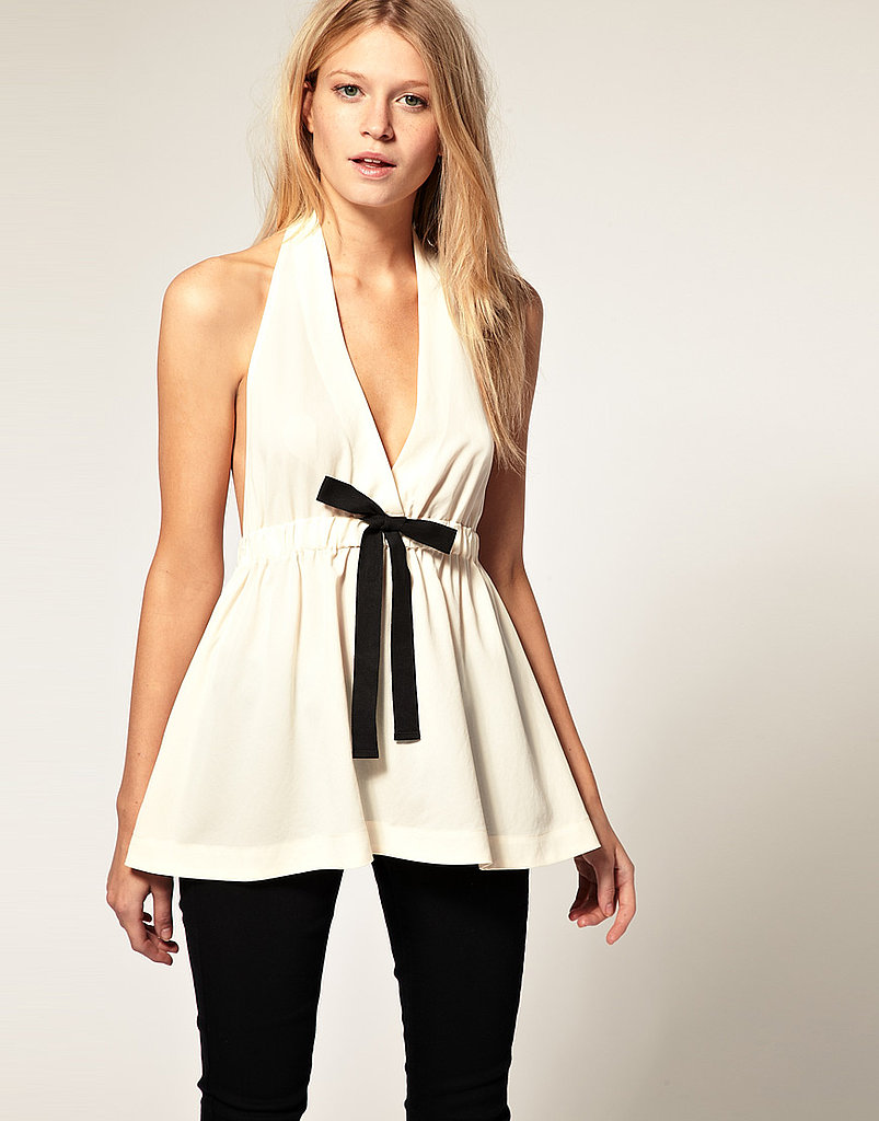 We love this feminine take on tux luxe. This one would be perfect for our adorable (and very stylish) preggers editor, Noria Morales.   ASOS Draped Bow Top ($64)