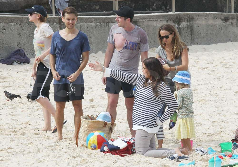 Tobey Maguire and his family on the beach in Australia.