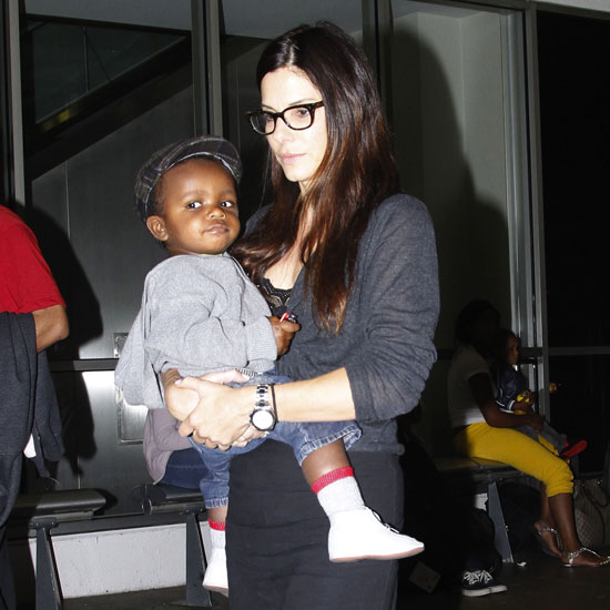 Sandra and Louis Bullock Leave Austin and Arrive at LAX Pictures