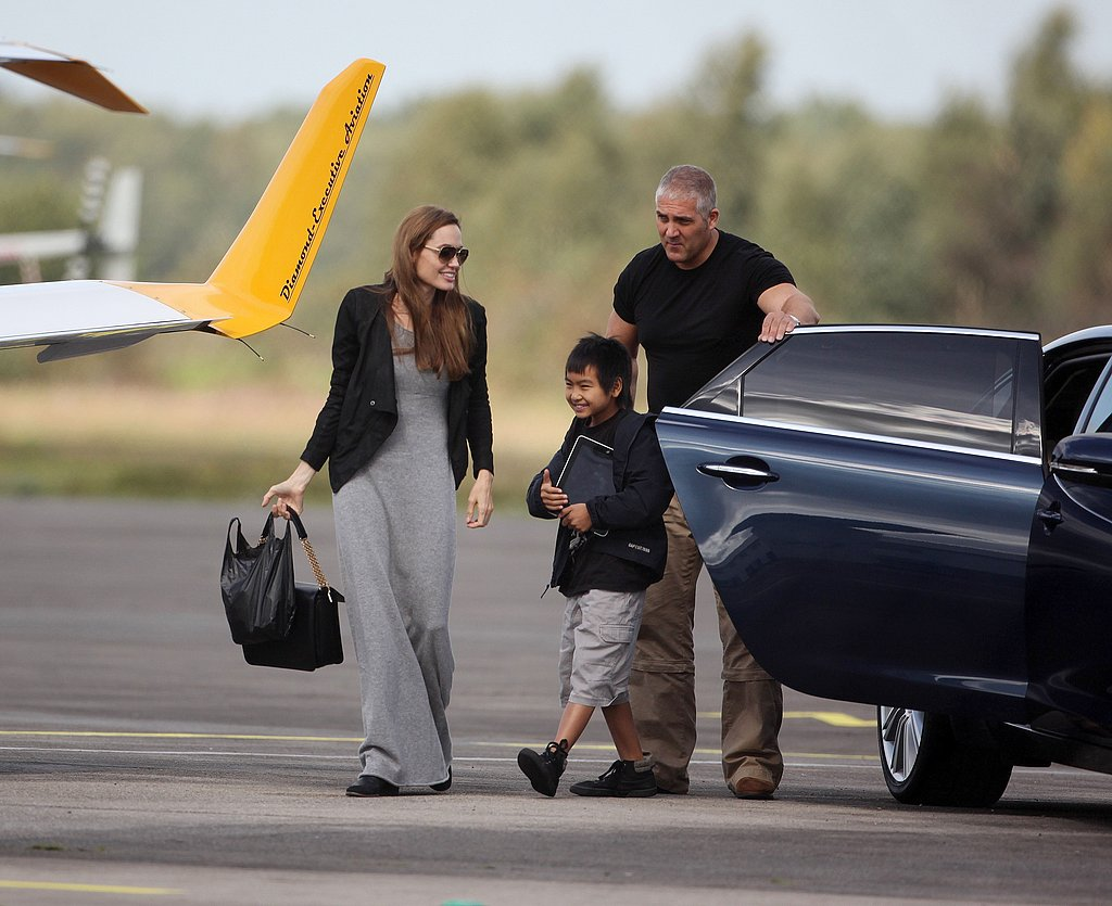 Angelina Jolie and Maddox Jolie-Pitt arrive an a UK airport.