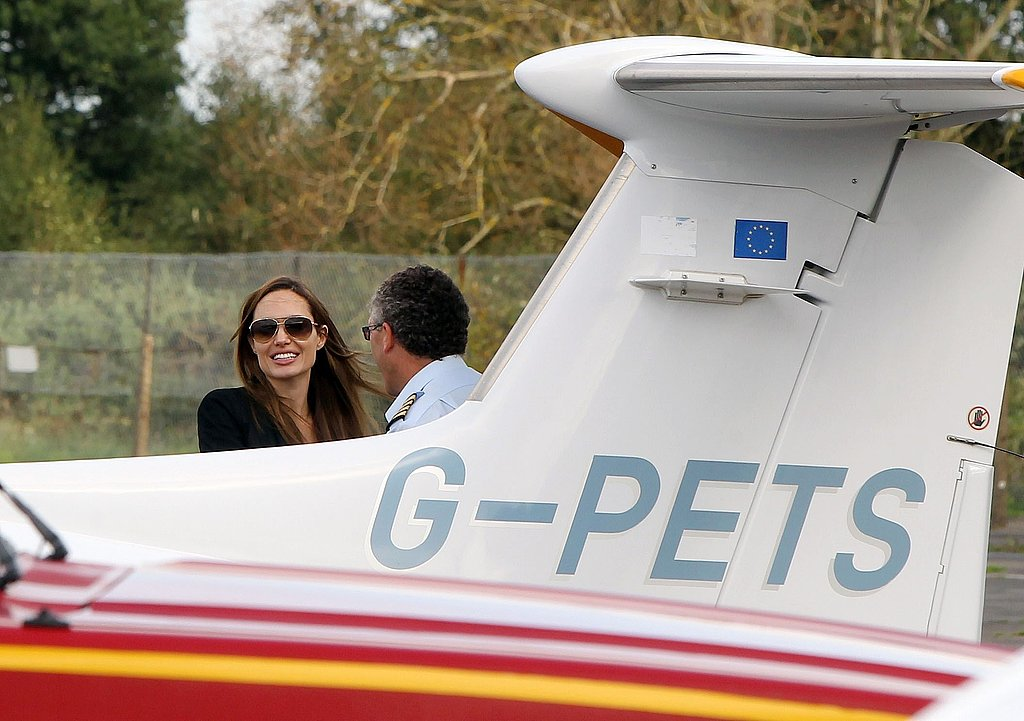 Angelina Jolie preps for her flying lesson.