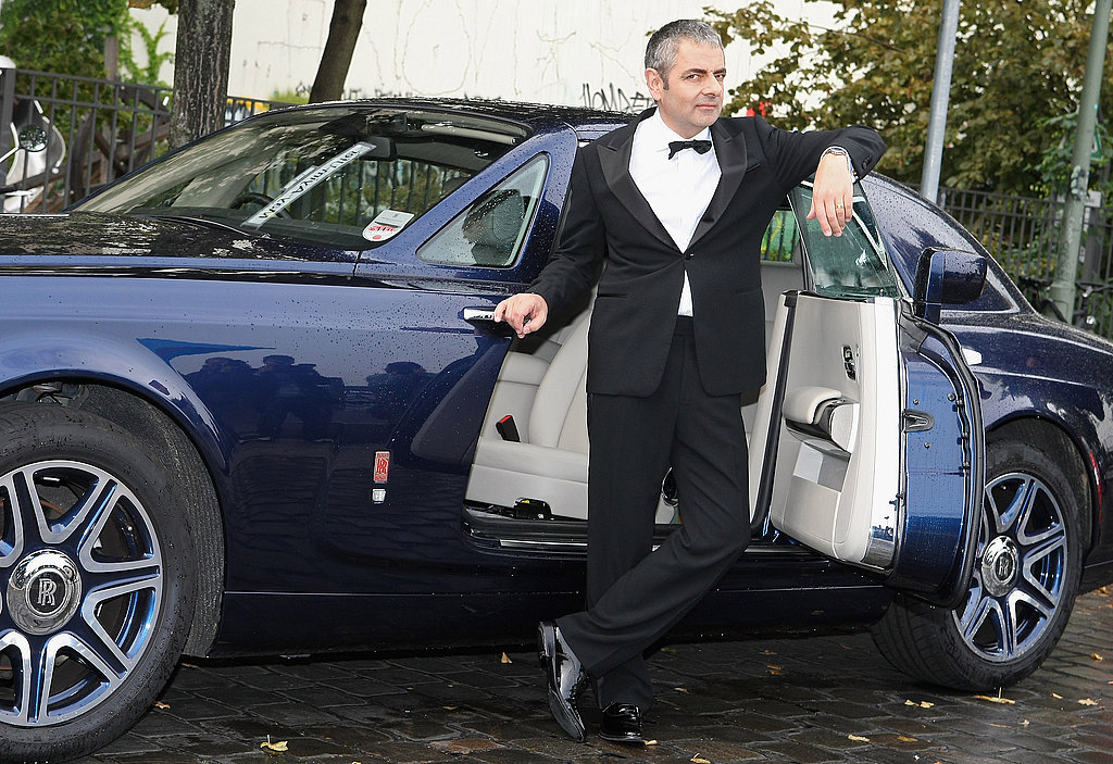 Rowan Atkinson posed with the Rolls Royce that features in Johnny English Reborn at the film's German premiere on Sept. 27.