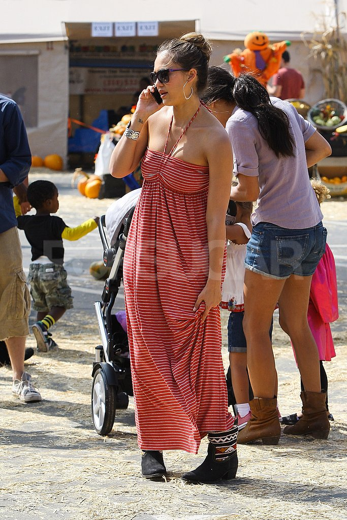 Jessica Alba paired boots with a maxi dress.