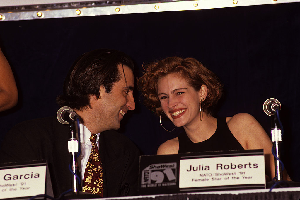 Julia giggled with Andy Garcia at the Showest Convention in 1991.