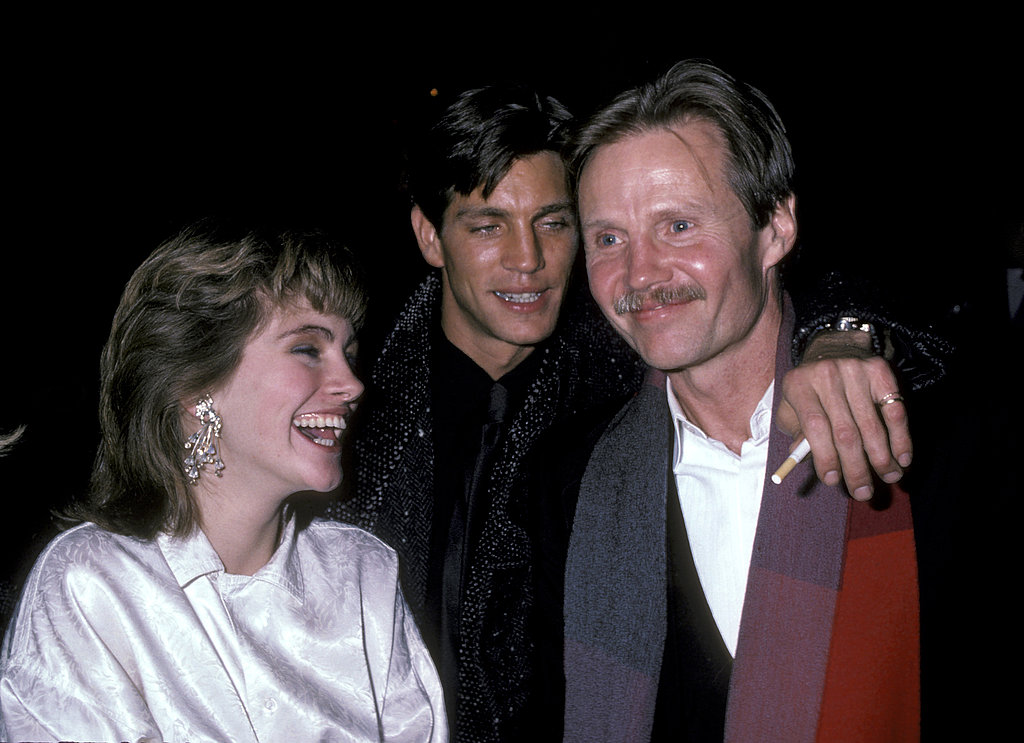 Julia laughed even while sporting heavy eyeshadow and a feathered haircut at a movie premiere with brother Eric and actor Jon Voight.