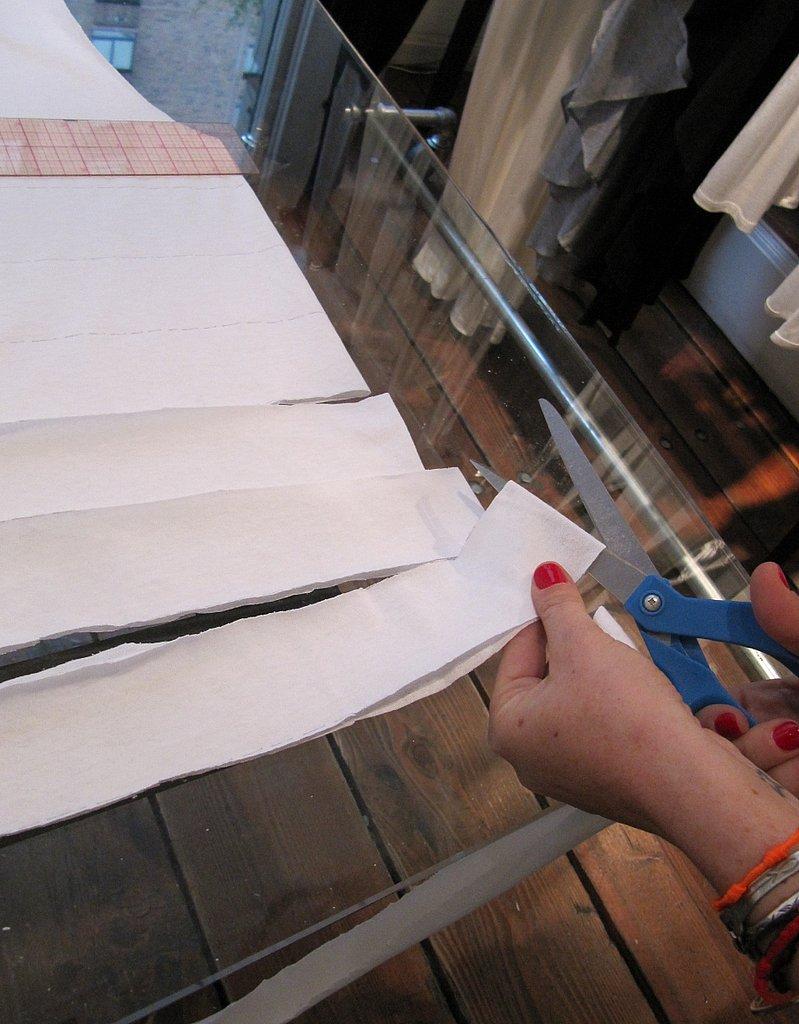 Cut each strip at one end to make one long strip.