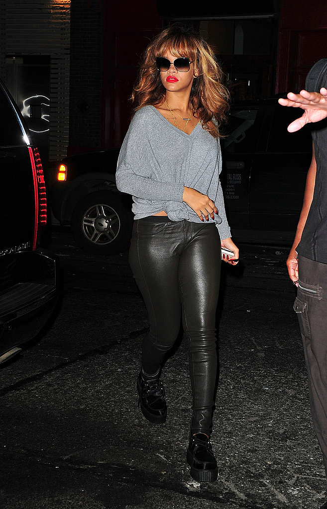 Rihanna added a knit top to slick leather pants for edgy cool on the go.