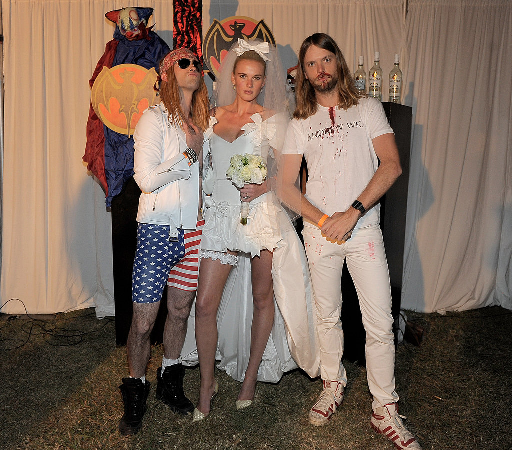 Adam Levine, Anne Vyalitsyna, and James Valentine at the Maroon 5 Halloween party.