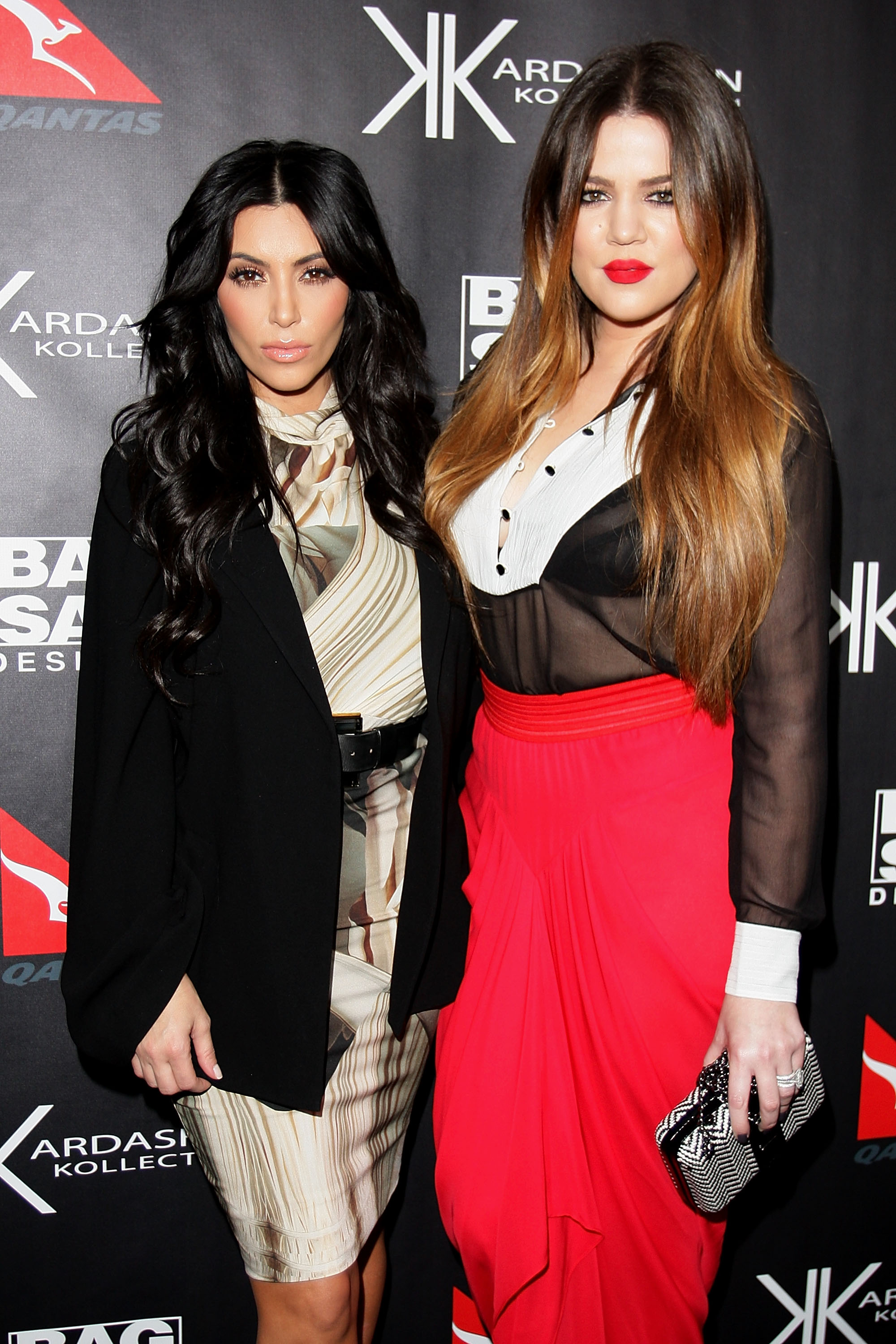 Kim and Khloe Kardashian kept straight faces for the cameras.